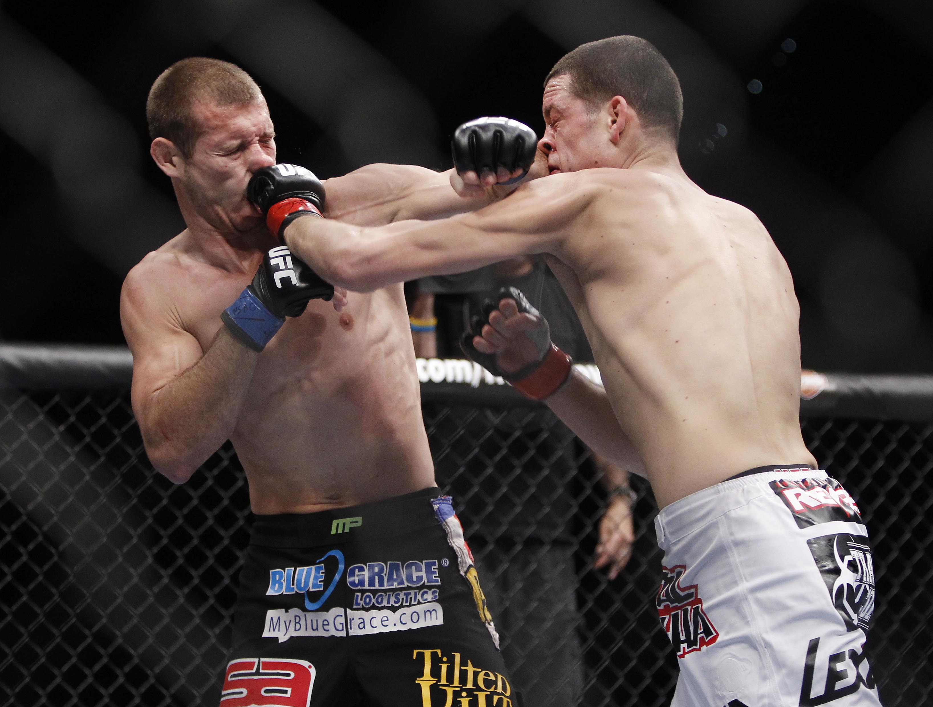 Nate Diaz, right, hits Donald Cerrone their UFC lightweight match in Dec., 2011. (AP)