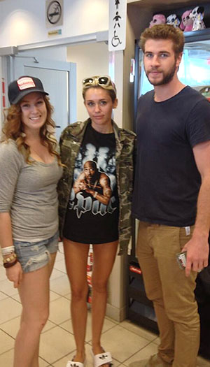 Cyrus and Hemsworth with a fan in Canada (Twitter)