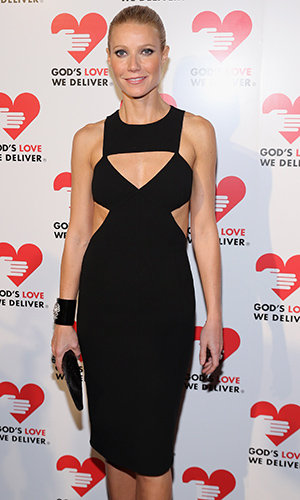 Gwyneth goes solo on the red carpet. (Getty Images)