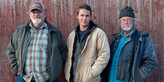 "Brendan Gleeson, Taylor Kitsch, and Gordon Pinsent in ""The Grand Seduction."""