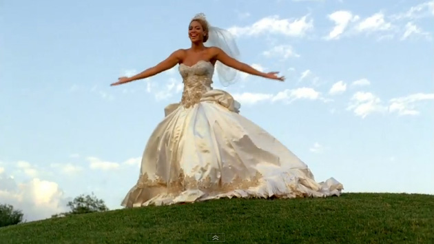 the huuuuge wedding dress she changes into complete with fairy tale