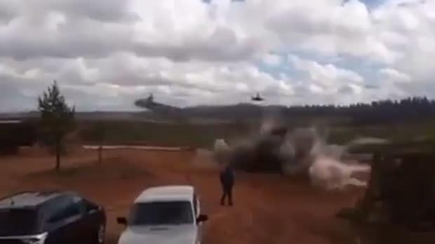 Watch moment Russian helicopter 'accidentally fires rockets at bystanders'