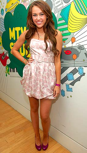 15-year-old Miley Cyrus is pretty in pink. - Michael Loccisano/FilmMagic.com