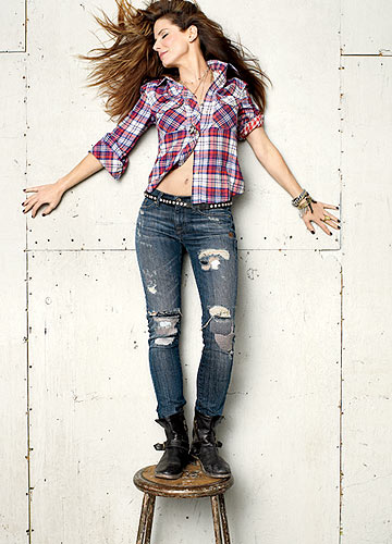 The actress strikes a dramatic pose in a plaid shirt and shredded jeans. - Peggy Sirota/Glamour