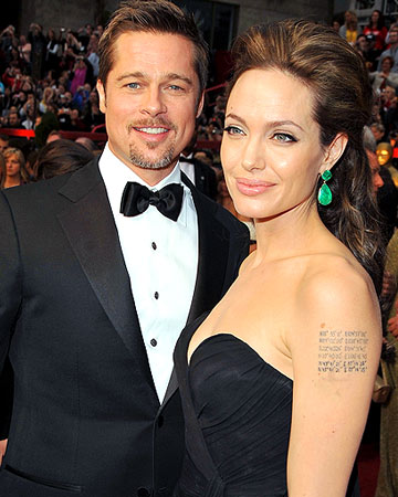 Brad Pitt and Angelina Jolie love their tattoos! - Steve Granitz/WireImage.com