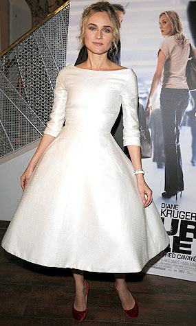 Diane Kruger strikes a pose in an ivory pocketed Giambattista Valli dress. - Pascal Le Segretain/Getty Images