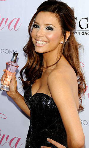 Eva Longoria pops a pose with her new fragrance at Beso in Hollywood. - Jean Baptiste Lacroix/WireImage.com