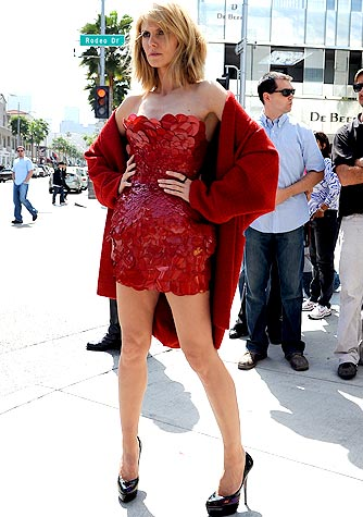 Heidi Klum strikes a pose on Rodeo Drive in a red scaly frock by Giles Deacon. - Splash News
