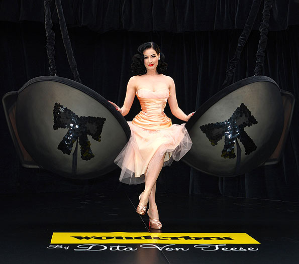 Dita Von Teese introduced her new lingerie line in London while perched upon a giant padded sequined bra. - Mike Marsland/WireImage.com