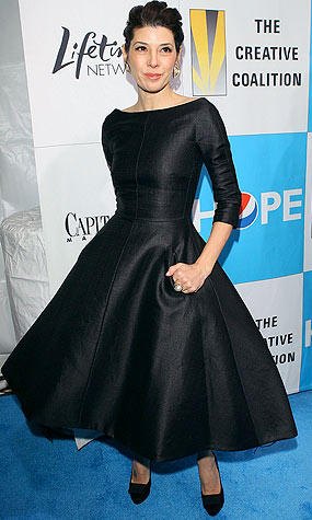 Marisa Tomei rocks a darker version of the same flouncy frock. - Michael Tran/FilmMagic.com