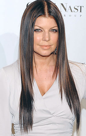 Now her hair is dark and sleek - Dimitrios Kambouris/WireImage.com