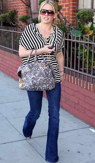 Hilary Duff struts her stuff in perfectly fitted jeans and a cute striped top. - Turner/Splash News