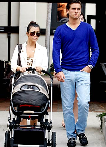Scott Disick with his lady love, Kourtney Kardashian, and their new arrival, Mason. - Splash News