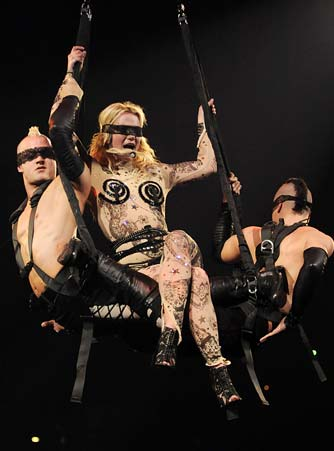 Uh, full-body tattoo suit? That's a don't. Was Brit's dad okay with this getup? - Kevin Mazur/WireImage.com