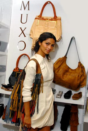 Camila Alves shows off a handbag from her MUXO collection. - Mark Sullivan/WireImage.com