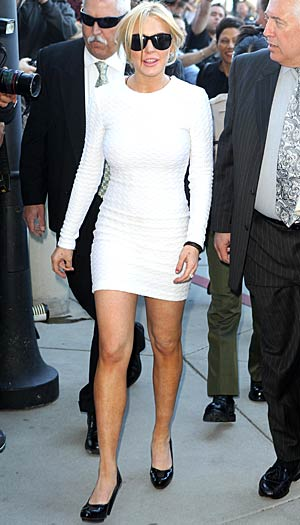 Lindsay Lohan shows up to court sporting a body-hugging white dress. - Splash News