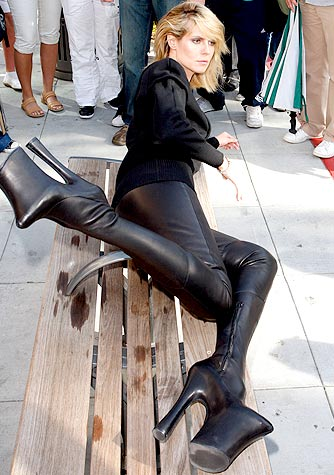 Heidi kicks back in a pair of thigh-high Alexander McQueen platform boots. - Splash News