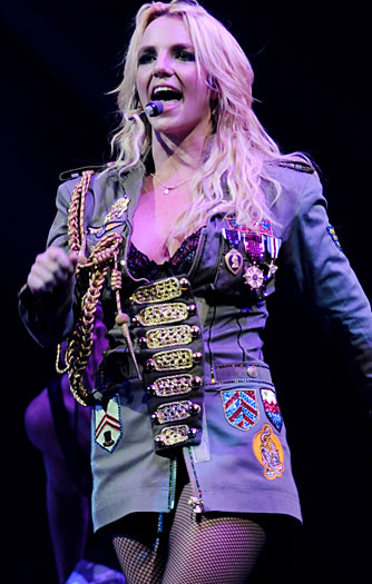 I can't help but think a lot of these outfits are inspired by the 20 plus years of Madonna concert fashion. Oh well, this military jacket looks great on Brit. A strong look for the pop star hoping to make this comeback stick! - Kevin Mazur/WireImage.com