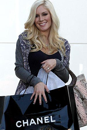 Heidi Montag proudly shows off her nails adorned with the Chanel logo. - Perkins/Shirley/PacificCoastNews.com