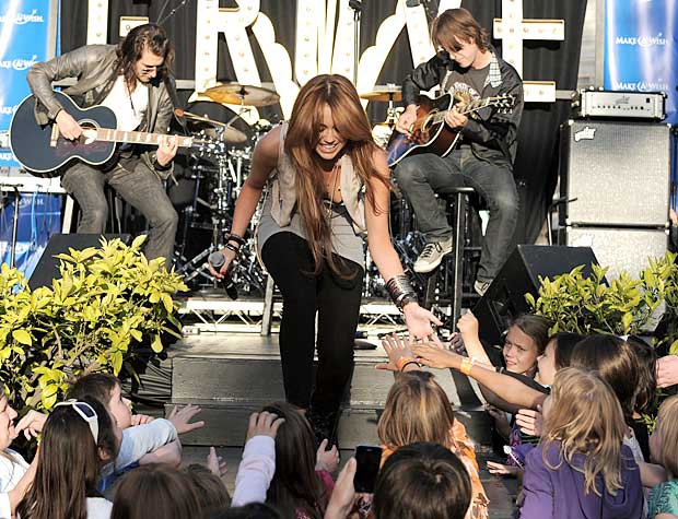 "The ""Party in the USA"" singer greets an excited crowd at The Grove in LA. - Jordan Strauss/WireImage.com"