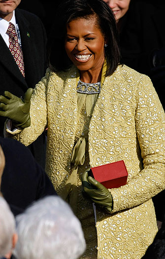 Michelle Obama sparkled in a yellow-gold Isabel Toledo dress and coat. - Chip Somodevilla/Getty Images