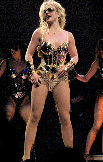 Spears shows off her fit figure in another ode to Madonna -- Madge's gold cone-bra corset outfit from her Gaultier era. I think I like Brit's take on it better. - London Entertainment/ Splash News