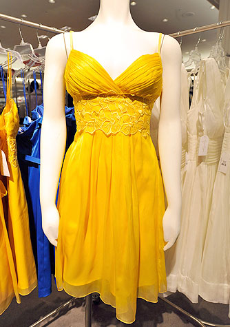 This bright yellow frock accentuates all the right curves. - Kevin Mazur/WireImage.com