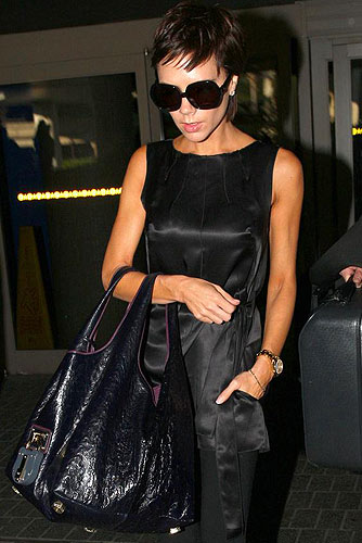 Victoria Beckham makes her way through LAX toting a Loewes Calle ostrich bag worth almost 10 grand! - Breeden, Butterworth/PacificCoastNews.com