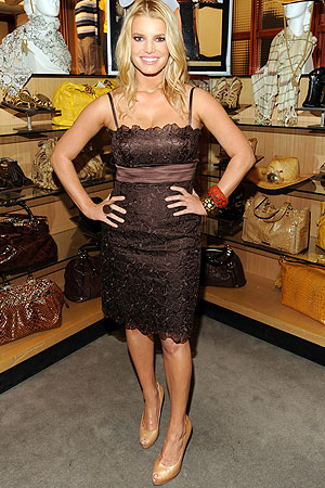 Jessica Simpson pairs a chocolate embroidered dress from her collection with a pair of Jessica Simpson pumps and Louis Vuitton bangles. - Kevin Mazur/WireImage.com