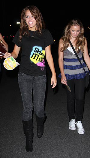 Miley Cyrus and a friend are spotted leaving a Coldplay concert in L.A. - AlphaX/X17online.com