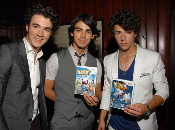 Kevin, Joe, and Nick Jonas nabbed copies of the hot new Nintendo Wii game, Rayman Raving Rabbids TV Party. - Mark Sullivan/WireImage.com
