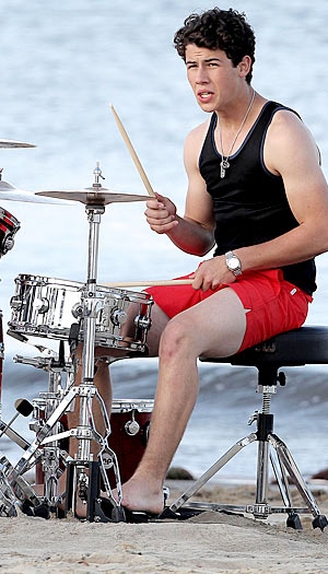 Nick Jonas shows off his guns while keeping the beat. - Gaz Shirley/Kevin Perkins/PacificCoastNews.com