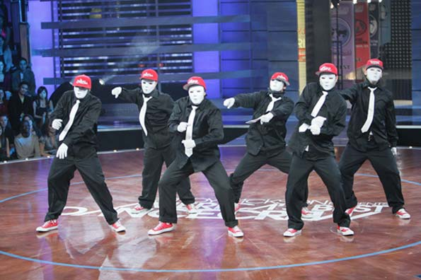 The masked men of JabbaWockeeZ demonstrate their smooth moves. - Chris Polk/WireImage.com