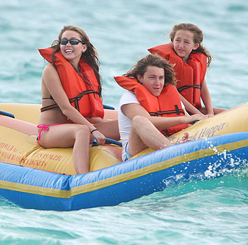 The Cyrus siblings try their hand at rafting. Look how clear the water is! - SDFL/Sinky/Splash News