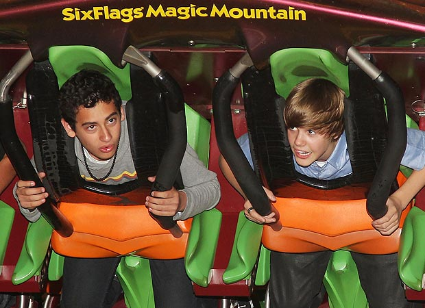 Justin Bieber gets ready to take a ride at Six Flags Magic Mountain in Valencia, California. - Mathew Imaging/WireImage.com