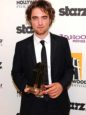 Clad in black, Robert Pattinson looked like a real-life vampire. - Jordan Strauss/WireImage.com