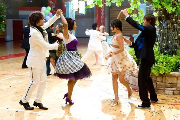 Chad (Corbin Bleu) and Troy (Zac Efron) twirl their girls! - Disney Enterprises, Inc.