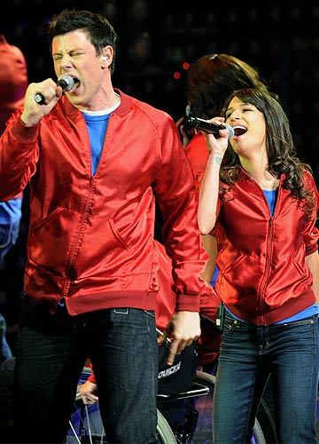 """Don't stop believin', hold on to that feeeeeeeeling!"" sing Finn (Cory Monteith) and Rachel (Lea Michele). - Kevin Winter/Getty Images"
