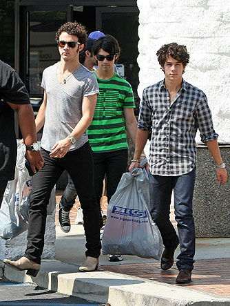 The Jonas Brothers load up on athletic gear at Big 5 Sporting Goods. - Clint Brewer/Splash News