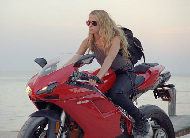As Number Six, Palmer's favorite mode of transport is her red Ducati bike. - Dreamworks