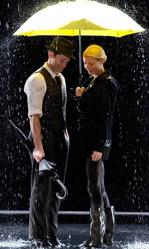 "Mr. Schuester (Matthew Morrison) and Ms. Holliday (Gwyneth Paltrow) get caught in a rainy duet on Tuesday's episode of ""Glee."" - FOX"