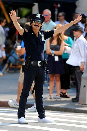 Joe is so cute in uniform! He dressed up as a NYPD officer while filming scenes for the Jonas Brothers 3-D movie this week. - Doug Meszler/Splash News