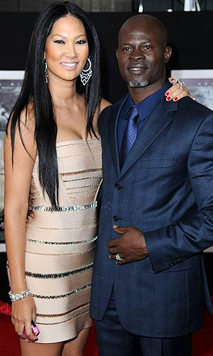 "Kimora and Djimon Hounsou at the premiere of ""The Tempest"" in L.A., December 6, 2010. - Frazer Harrison/Getty Images"