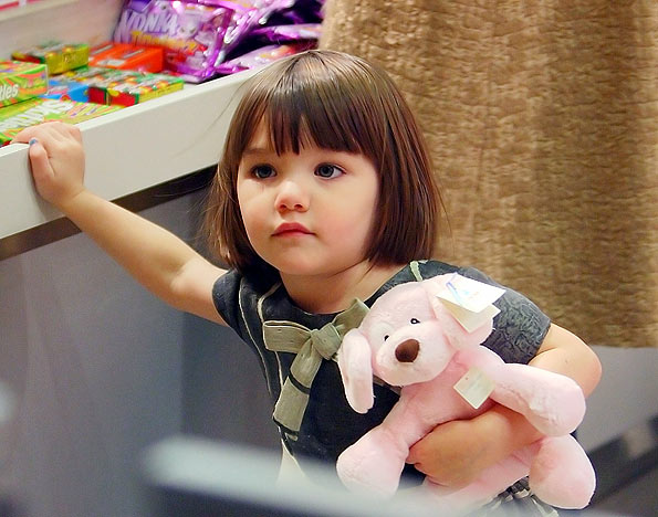 The adorable toddler cuddles with a pink pooch. - Jackson Lee/Splash News