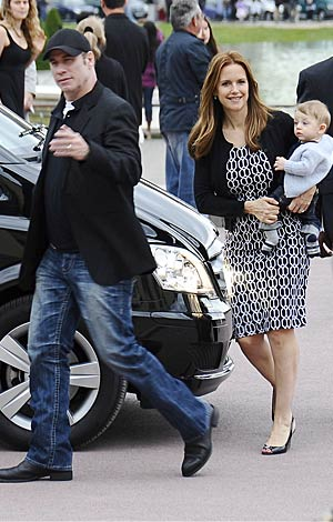 John Travolta, Kelly Preston, and 7-month-old Benjamin arrive in Paris for Father's Day weekend. - PacificCoastNews.com