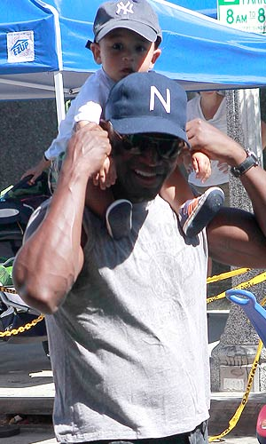 Taye Diggs is all smiles while giving his son Walker a lift. - CelebrityJuicer/Splash News