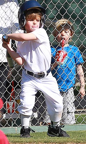 Jayden looks on as his big bro steps up to bat. - Sam Sharma/Miguel Aguilar/PacificCoastNews.com