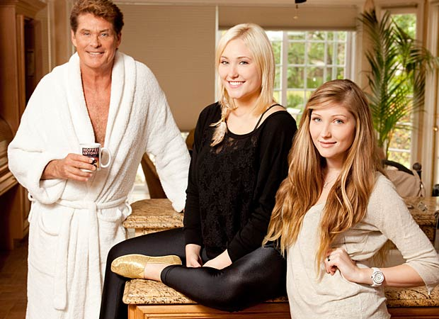 "Hasselhoff (with daughters Hayley, left, and Taylor-Ann) insists that despite their showbiz lifestyle, they are just a ""regular family"" who are ""fiercely loyal to each other."" - A&E"