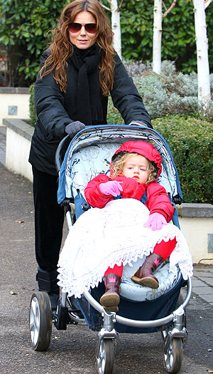 Geri Halliwell and her daughter Bluebell Madonna brave the cold in London. - Goff/INFphoto.com