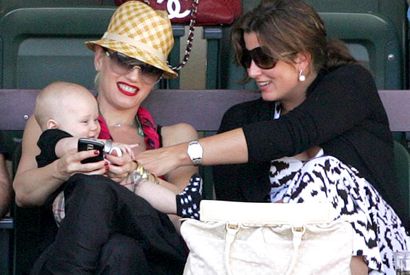Gwen Stefani and her baby boy take in a tennis match with Roger Federer's girlfriend, Mirka Vavrinec. - Juan Soliz/PacificCoastNews.com